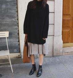 Black sweater dress, beige skirt, black ankle boots & tan tote bag | @styleminimalism