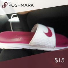 a6c98e04e976dc Shop Women s Nike Pink White size Sandals at a discounted price at  Poshmark. Description  Pink n white Nike slides.