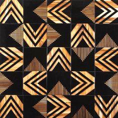 """Quase um ebanizado, o painel da linha """"Tribal"""" surpreende pelas belas formas geométricas."""