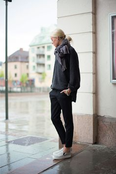 Black trousers, chunky retro-y sneakers, scarf