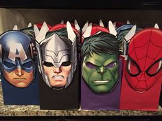 Goodie bag ideas for an Avenger birthday party. I used one piece of tape to connect the mask to the bag so that the kids can easily remove the mask and wear it at the birthday party. Masks were from Target, goodie bags (in bulk) from Oriental Trading.