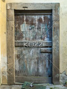 view of a old wooden door. - Image of a weathered closed wooden door of a house.