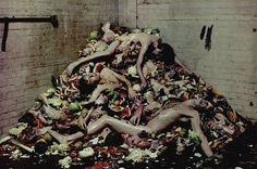 """What I found amazing about Lee (McQueen) is that he would pursue an idea regardless of the consequences. As we started draping the three pale male models on this huge mound of pigs heads and rotting food to look as though they were dead suddenly the atmosphere became very intense. It was a warm day so the smell was really pungent and that heightened the whole experience too. I remember Lee running around smashing watermelons on set to add to the pile he was always so involved and hands-on…"