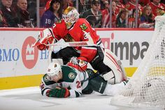 Stay down:   Goalie Scott Darling #33 of the Chicago Blackhawks pushes down Nino Niederreiter #22 of the Minnesota Wild on Mar. 20 in Chicago. The Wild defeated the Blackhawks 3-2.  -      © Bill Smith/NHLI/Getty Images