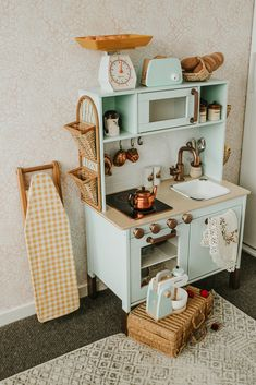 IKEA DUKTIG play kitchen hack I based Alice's kitchen on my childhood kitchen in the UK. The play kitchen was a hacked IKEA DUKTIG and all other items were loving sourced from op shops around Melbourne to help give it a vintage feel. Ikea Kids Kitchen, Diy Play Kitchen, Kitchen Hacks, Ikea Childrens Kitchen, Toddler Kitchen, Montessori Playroom, Toddler Playroom, Toy Rooms, Play Houses