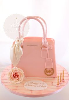 Michael Kors 3D shaped cake www.facebook.com/... #michaelkorscake #pursecake #mk #maryamscakery #pink #girlycakes #birthdaycake