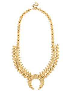An oversized tribal statement done in antique gold is a fierce finishing touch.