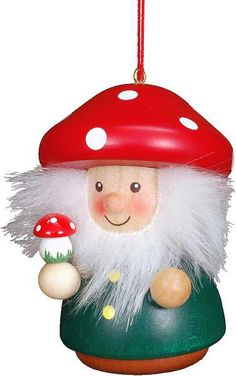 Bring a charming Christmas scene to your holiday décor with the Christian Ulbricht Mushroom Man Christmas Ornament. This ornament is skillfully handcrafted from wood and painted in vibrant colors. Wooden Ornaments, Hanging Ornaments, Christmas Ornaments, Christmas Decorations, Christmas Tree, Red And White Mushroom, How To Make Ornaments, Stuffed Mushrooms, Christian