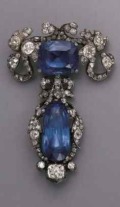 AN ANTIQUE SAPPHIRE AND DIAMOND BROOCH. Designed as a cushion-cut sapphire within an old-cut diamond foliate mount, suspending a detachable drop-shaped sapphire within similar mount, mounted in silver and gold, circa 1870, 6.0 cm. high, in original black case by Nativelle, Paris. #Antique #brooch