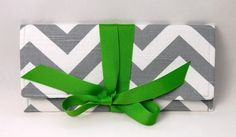 Clutch in gray and white chevron stripe with green bow. The ALEXIS Clutch.