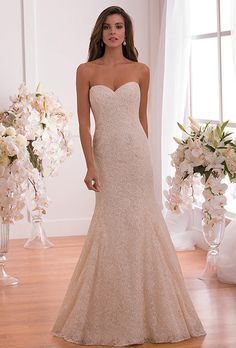 Jasmine Collection. A simple and elegant silhouette is made extravagant with a layer of Alencon Lace that covers the entire gown. The strapless sweetheart neckline and fit and flare skirt make for a modern and luxurious wedding dress.