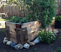 River rock and a trellis make this HighRiser garden bed interesting