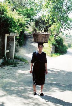 Calabria Monterosso woman w basket on head