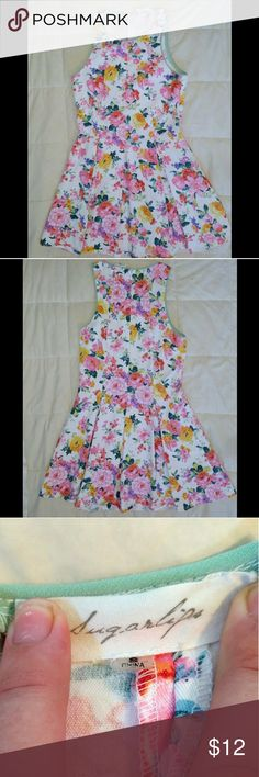 Floral Sugarlips Mini Dress Floral mini dress, in very good condition. Has one small flaw on the right shoulder where the stitching is beginning to loosen, but beyond that I can't find any other flaws. Sugarlips Dresses Mini