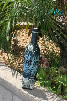 Chalkboard Paint on an unopened bottle of wine for a gift basket… The sky is the limit! I made it a beach theme since we live by the beach :)