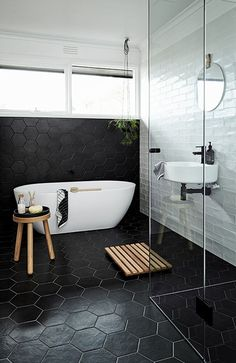 Black octagonal bathroom tiles.  Nord House in Australia is a Scandi style weekend getaway just outside Melbourne designed by Poss Samperi of Orchard Keepers on the Mornington Peninsula.