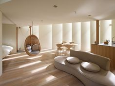 Fujiwaramuro Architects have designed a house for a family in Kyoto, Japan.  large fins let in light, maintain privacy