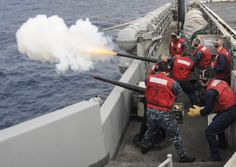 PACIFIC OCEAN (May 7, 2014) Sailors fire a 40mm saluting cannon from the flight deck of the aircraft carrier USS Nimitz (CVN 68) in preparation for an upcoming ceremony. Nimitz is underway conducting flight deck certifications. (U.S. Navy photo by Mass Communication Specialist 3rd Class Siobhana R. McEwen/Released)