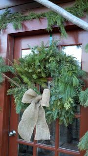 greens wreath with burlap bow