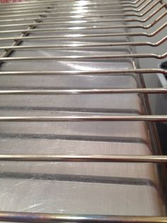 How to clean dirty oven and stove racks: Soak racks in the bathtub overnight. Soak in warm water, a half cup of Dawn dish soap, and 8 dryer sheets. Use dryer sheets to wipe off any extra grease.