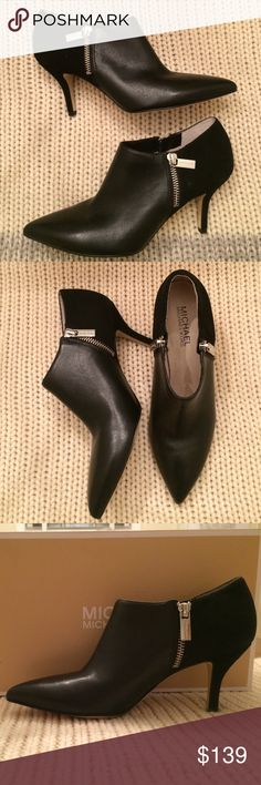 """Michael Kors Leather and Suede Bootie Sexy and sleek black Michael Kors Bootie. Zipper closure in each side. Leather in front and Suede behind zipper. 3"""" covered heel. Michael Kors Shoes Ankle Boots & Booties"""
