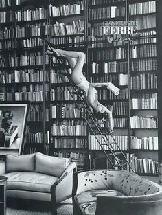 Linda Evangelista reading on library ladder. Clothing designer Gianfranco Ferré's Fall/winter 1992 campaign.