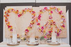 Giant Love & Peace backdrop DIY with paper flowers