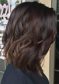 dark wavy hair with sutble caramel highlights