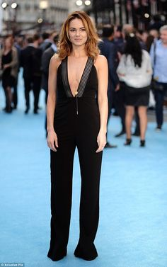 Style star: Mr Selfridge star Kara drew attention to her chest in a low-cut black jumpsuit as she posed alongside the film's stars and other famous names at Vue cinema in Leicester Square