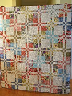 I've forgotten to tell you that my Disappearing Four Patch  has been quilted and bound and is now ready for the giving. The Official Cooki...