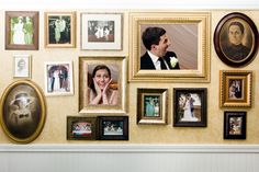 Photo Wall made by creating faux wall with frames and cutouts for people to stand behind. Photo by Fucci's Photos. fuccisphotos.com