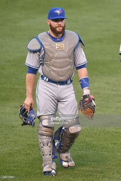 Russell Martin of the Toronto Blue Jays lwalks back to the dug out before a baseball game against the Baltimore Orioles at Oriole Park at Camden Yards on August 2016 in Baltimore, Maryland. The Blue Jays won Baseball Scoreboard, Baseball Games, Russell Martin, Baltimore Orioles, Baltimore Maryland, Mlb Players, American League, Toronto Blue Jays, Go Blue