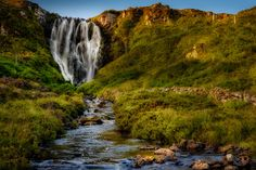 Clashnessie Falls - Clashnessie Falls, a beautiful fifteen meter waterfall, dropping from Loch an Easain and Loch nan Lub above. Situated in Assynt, Sutherland, Scotland.