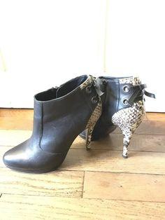 2452c279292e54 Low boots André en cuir noir et simili serpent