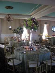 Green and Purple are one of my favorite color schemes for a wedding.  There were high and low centerpieces, which I know is always done, but it works.  Keeps your eye interested in looking around the room.