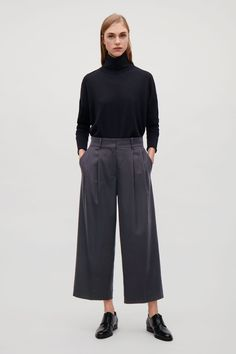 These trousers are made from a lightweight wool-blend flannel with a touch of stretch. A relaxed, wide-leg fit, they have neat press folds at the front and a back pocket.