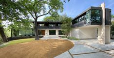 Taproot Studio in Dallas, Texas has designed this modern home which cantilevers out above a lot overlooking the beautiful Turtle Creek in Dallas, Texas. The existing modern corbels from the original single family home were preserved intact along with the sheer masonry walls of the original building. Additional structure was added to supplement the corbels in the projecting of balconies adjacent to the new second floor bedrooms and entertianment wing. Second Floor Addition, Masonry Wall, Dallas Texas, Balconies, Single Family, Custom Homes, Contemporary Design, Architecture Design, Turtle