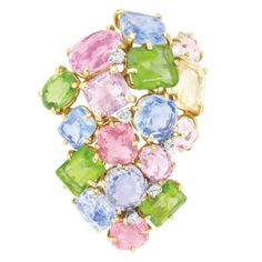 Gold and Multicolored Gem-Set and Diamond Clip-Brooch, Seaman Schepps  14 kt., the cluster brooch set with 4 cushion-shaped sapphires approximately 16.00 cts., one cushion-shaped yellow sapphire, one pink sapphire, 4 oval and emerald-cut peridots, 2 pink tourmalines and 3 quartz, accented by 5 round and old-mine cut diamonds, signed Seaman Schepps, circa 1940, approximately 18 dwt.