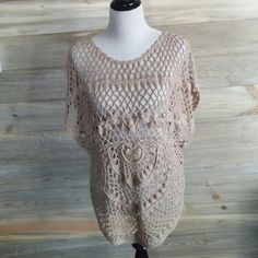 Boho crochet poncho This awesome little piece is in excellent condition and only been worn a couple times. It is perfect for festival season and a great piece to throw over tank tops or dresses in the summer. It's a large petite that could fit anyone from a small to a large very easily. 100% acrylic Dress Barn Tops