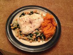 The Last Supper (before 3 liquid days.). Leftover cod grilled in lemon on a bed of chickpeas, spinach and onion with carrot and sweet potato mash.