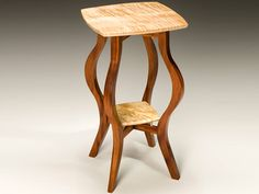 Curvz Wood End Table - Curvz wood table works as an end table or a plant stand in your living room. Custom made from mahogany and curly maple wood. Stunning artisan made furniture.