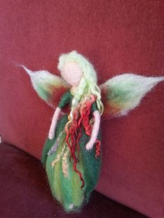 Introducing Fairy Cherry Tree. She is needle felted by hand in greens and dark red/burgundy, with a wire frame body so she can be very gently posed as you choose. She is aprox 22cm tall and 20cm wing to wing. She is for decoration only an not for children, due to her delicate nature and loose fibres. She does not have a thread for hanging but you can attach thread or ribbon if you want or she can sit or stand with support. She is made with love and care and took a whole day to make