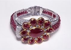 Reproduction of this image is strictly prohibited. info@newyorkjewelrydiary.com  Cartier London Art Deco Diamond Ruby Bracelet 1937, courtesy British Museum  Clive Kandel Jewelry Collection   www.newyorkjewelrydiary.com www.youtube.com/user/CliveKandel?feature=mhee  Clive Kandel Jewelry History Collection  Clive Kandel Cartier Collection