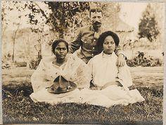 Filipino women with a Spanish soldier, circa 1890s.
