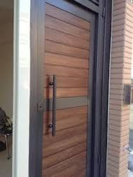 Image result for modern wood front doors