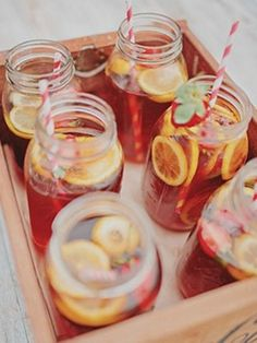 Recycle your old jam jars by filling them to the brim with your favourite fruity summer cocktail