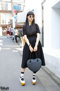 Yurico is a friendly girl with long black hair who we met in Harajuku. Her look features a black midi-dress from #HM with a Milk Harajuku heart-shaped bag, a Milk heart-shaped watch, and #Vivienne #Westwood rocking horse shoes.