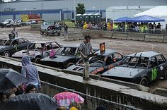 Car crunches and crowd cheers at the demo derby at the Fond du Lac county fair. Sunday, July 21, 2013. Patrick Flood/The Reporter Media.