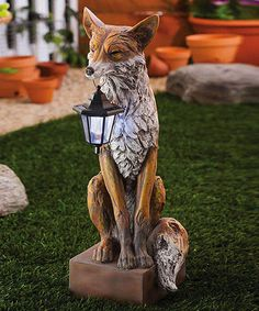 Appearing to be hand carved from wood, this polystone statuary makes a great accent decoration in almost any yard. Featuring a solar powered lantern, this statuary will provide around the clock decoration to your yard or outdoor space. Art Fox, Fuchs Illustration, Friendly Fox, Illustration Inspiration, Fox Decor, Solar Lanterns, Garden Statues, Wood Carving, Little Fox