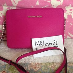 """Michael Kors Fuschia jet set messenger crossbody MICHAEL MICHAEL KORS JET SET LARGE Crossbody bag.This bag is brandnew, comes with Original tag.  Zip top closure with LOGO FRONT. 01 open LARGE COMPARTMENT 3 Slid pocket Logo jacquard lining Adjustable Chain and Leather shoulder strap with 25.5 drop 9"""" L  X 6""""H X 2""""D Silver hardware.                                               NO TRADE!!! Michael Kors Bags Crossbody Bags"""
